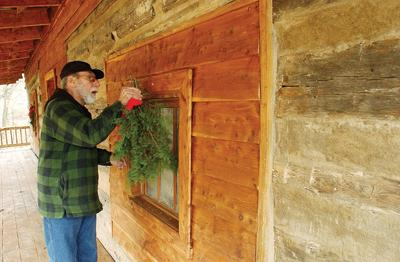 Vincent Zangaro Hangs Pine Boughs